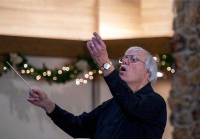 Robert Charles Howard conducting Oratorio Society of Estes Park